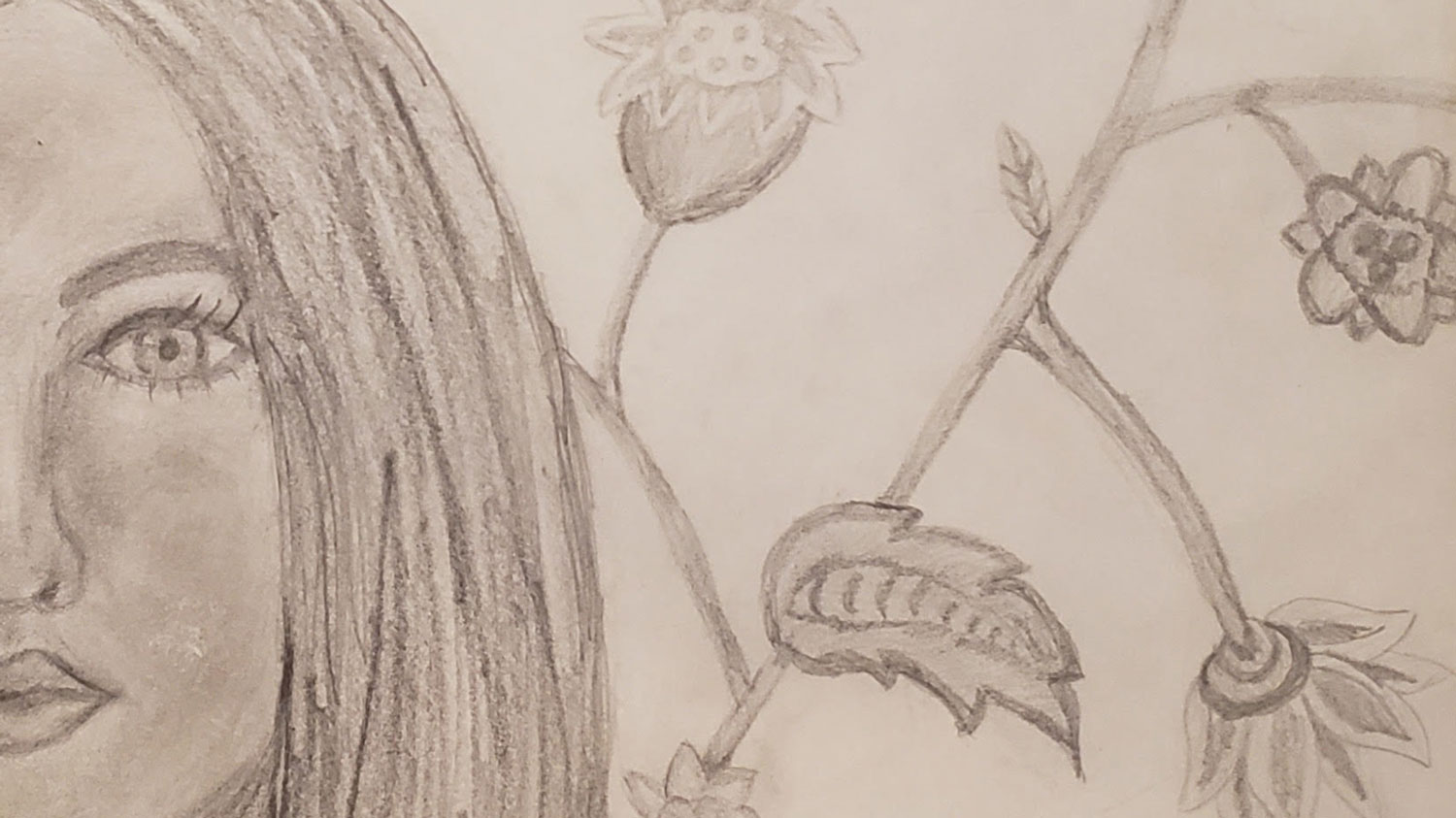 A drawing of a woman's face, leaves and flower buds.