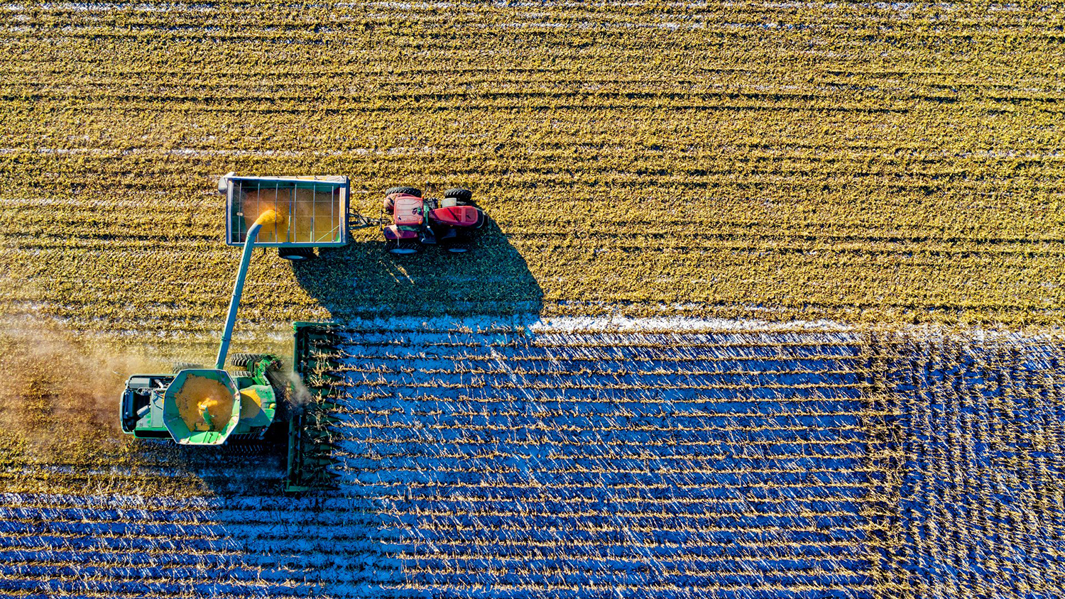 aerial view of a combine harvester in a field