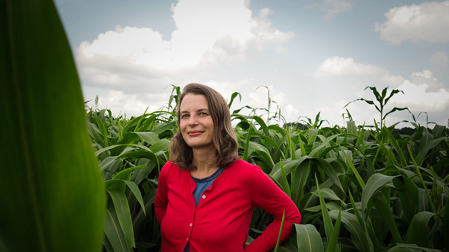Hannah Burrack in front of a corn field.