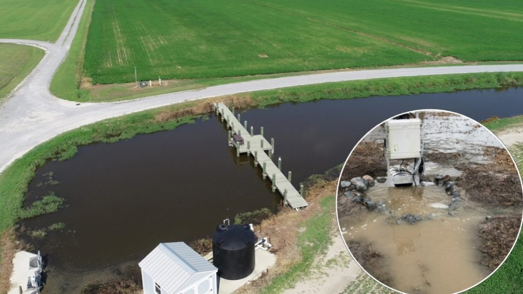 The drainage water recycling system employs a farm pond for storing water during wet periods. The water is used as supplemental irrigation during dry periods.