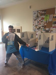 Image of Linden James presenting a Kids Voting on-site booth in 2019.