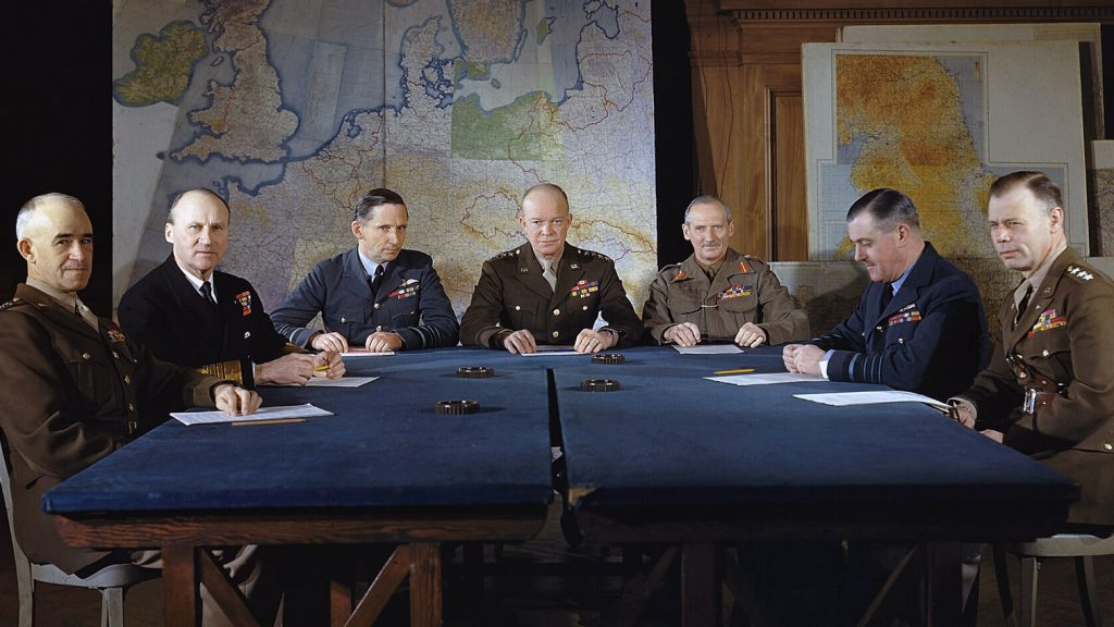 General Eisenhower and Allied leaders in front of military maps