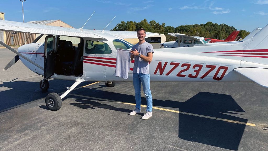 Andrew Berley with small-engine plane
