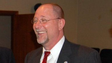 White man with beard smiling