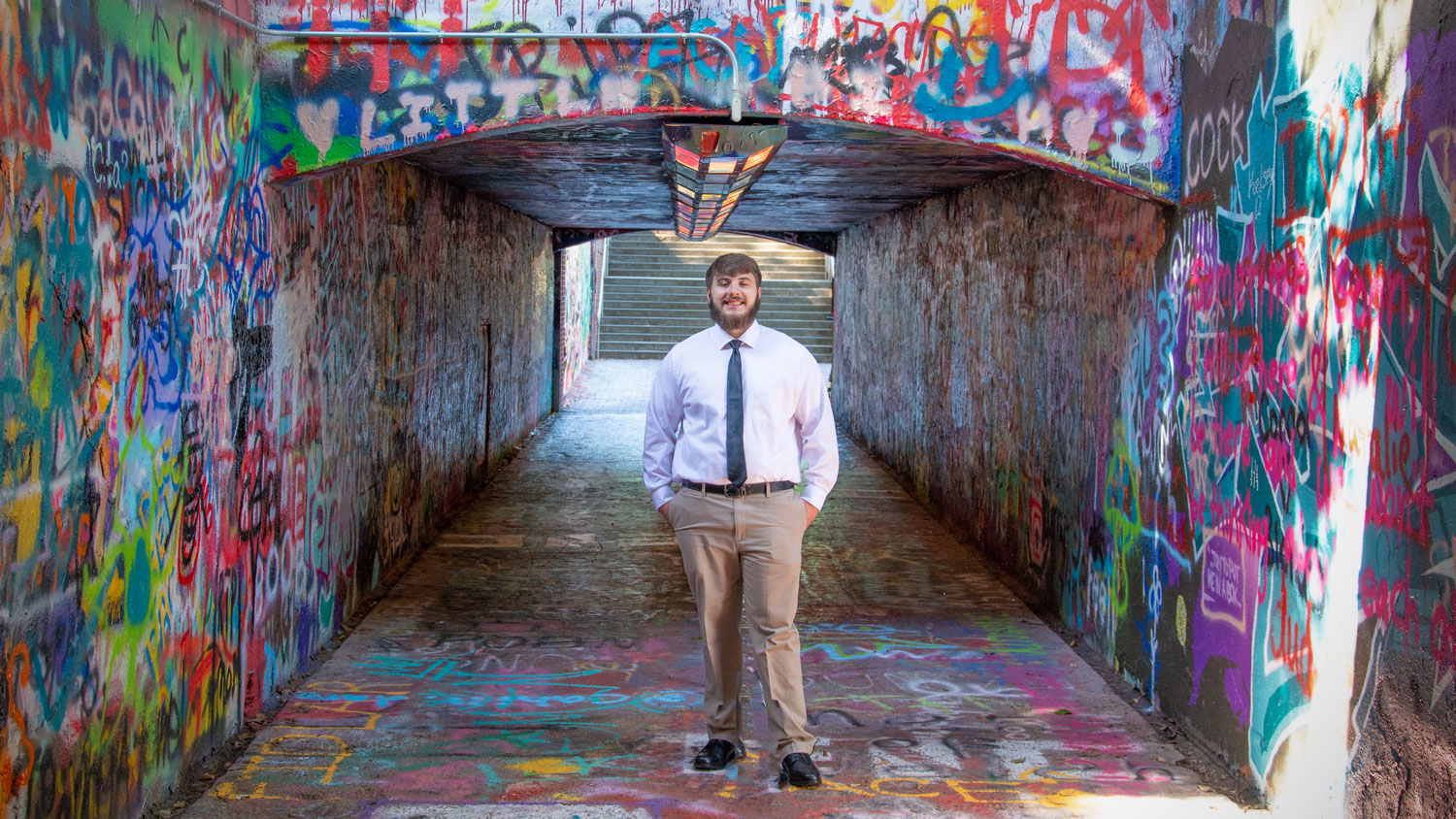 Ethan Thompson standing at the entryway of NC State's Free Expression tunnel.