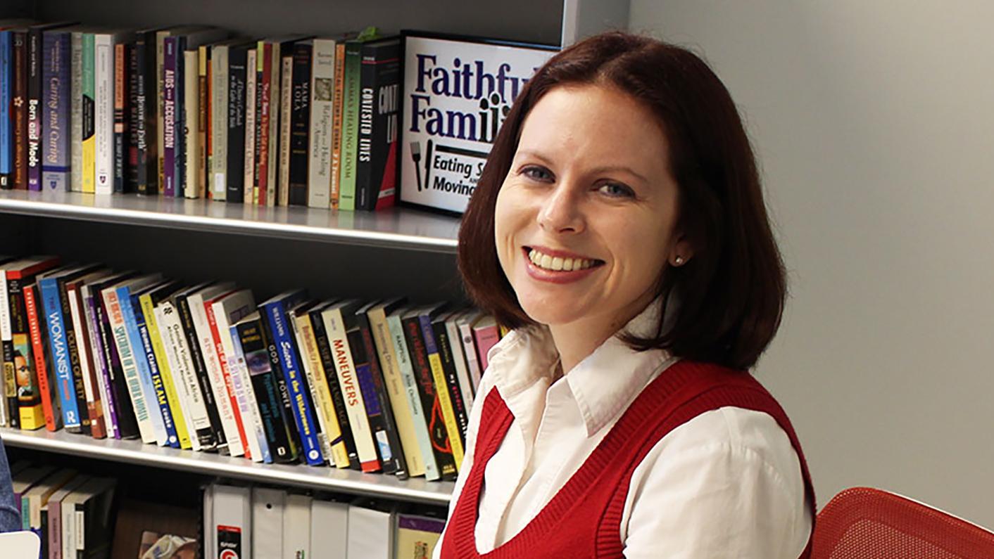 Woman beside bookshelves