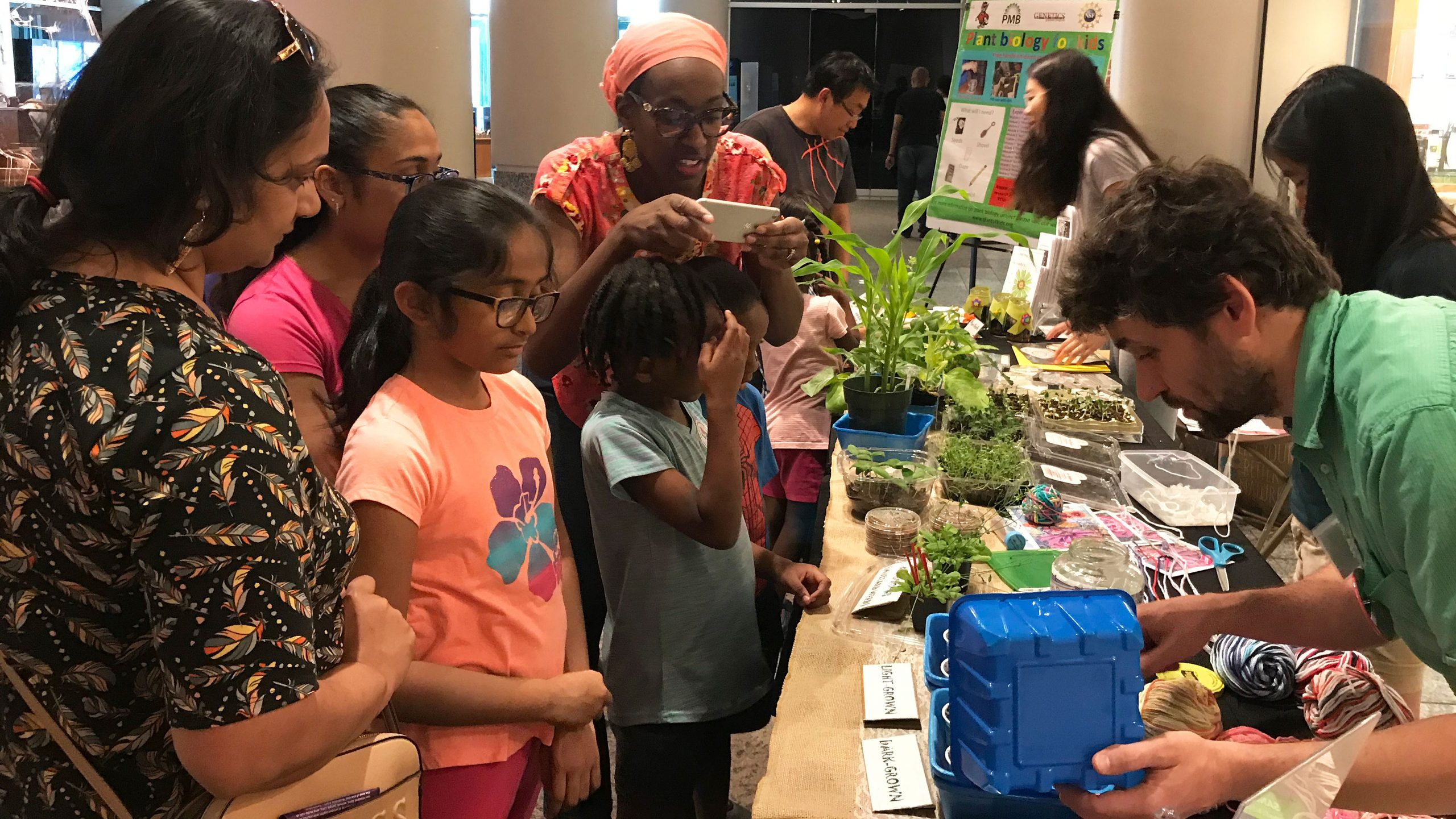 Families take part in a pre-pandemic Plant Biology for Kids event.