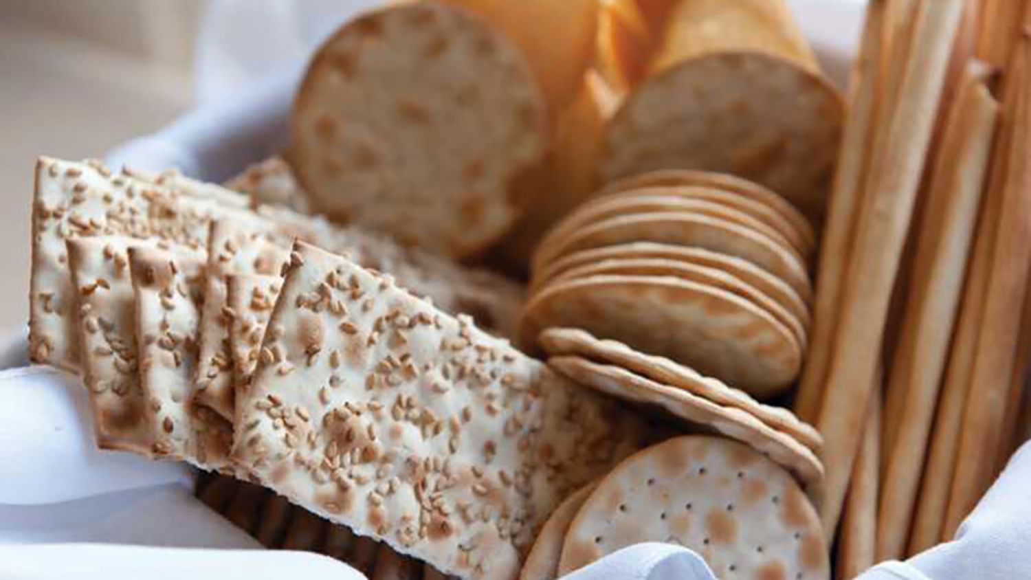 a variety of crackers in a basket