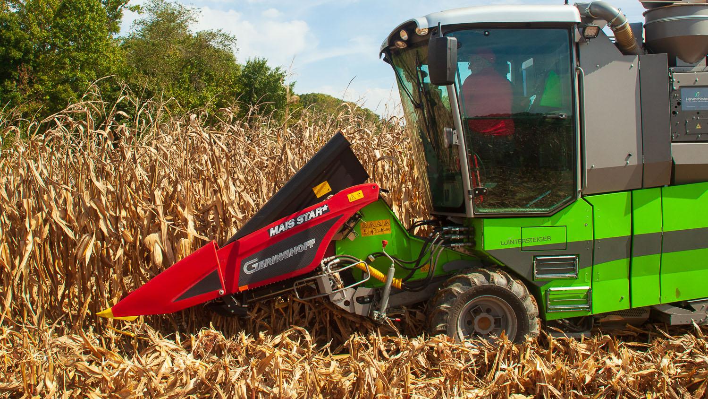 Combine in corn field