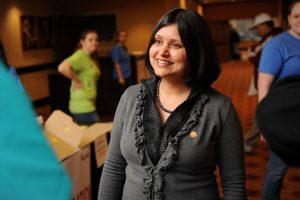 Dr. Shweta Trivedi, director of VetPAC, greets participants