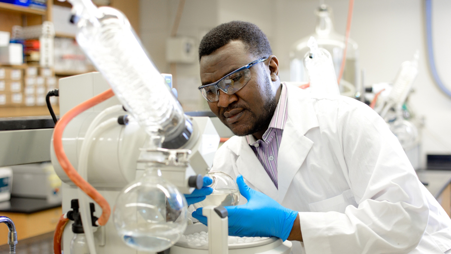 Male researcher works in lab.