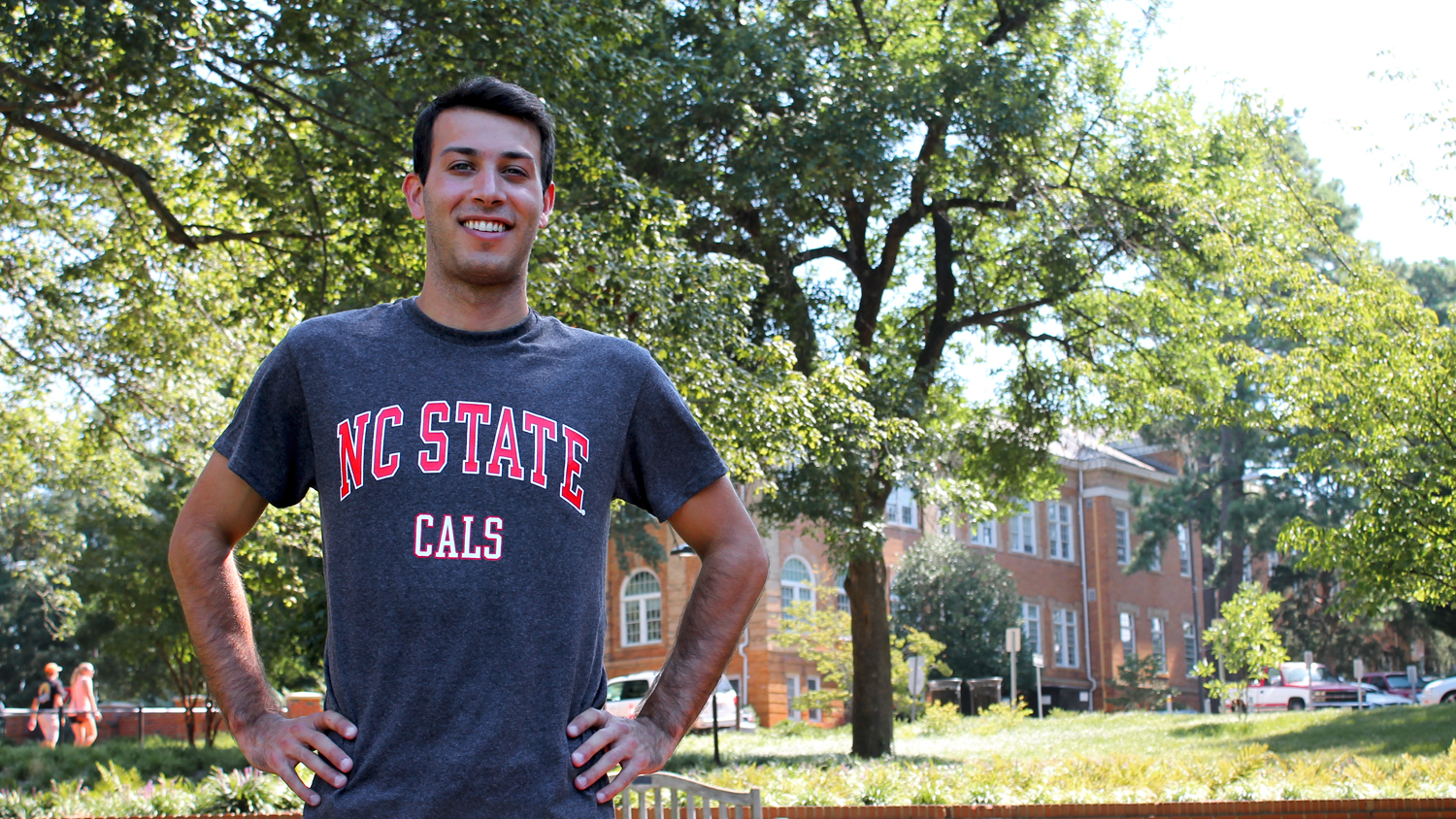 Olympic diver and Physiology Program graduate student Nick McCrory in front of Patterson Hall on NC State's campus.