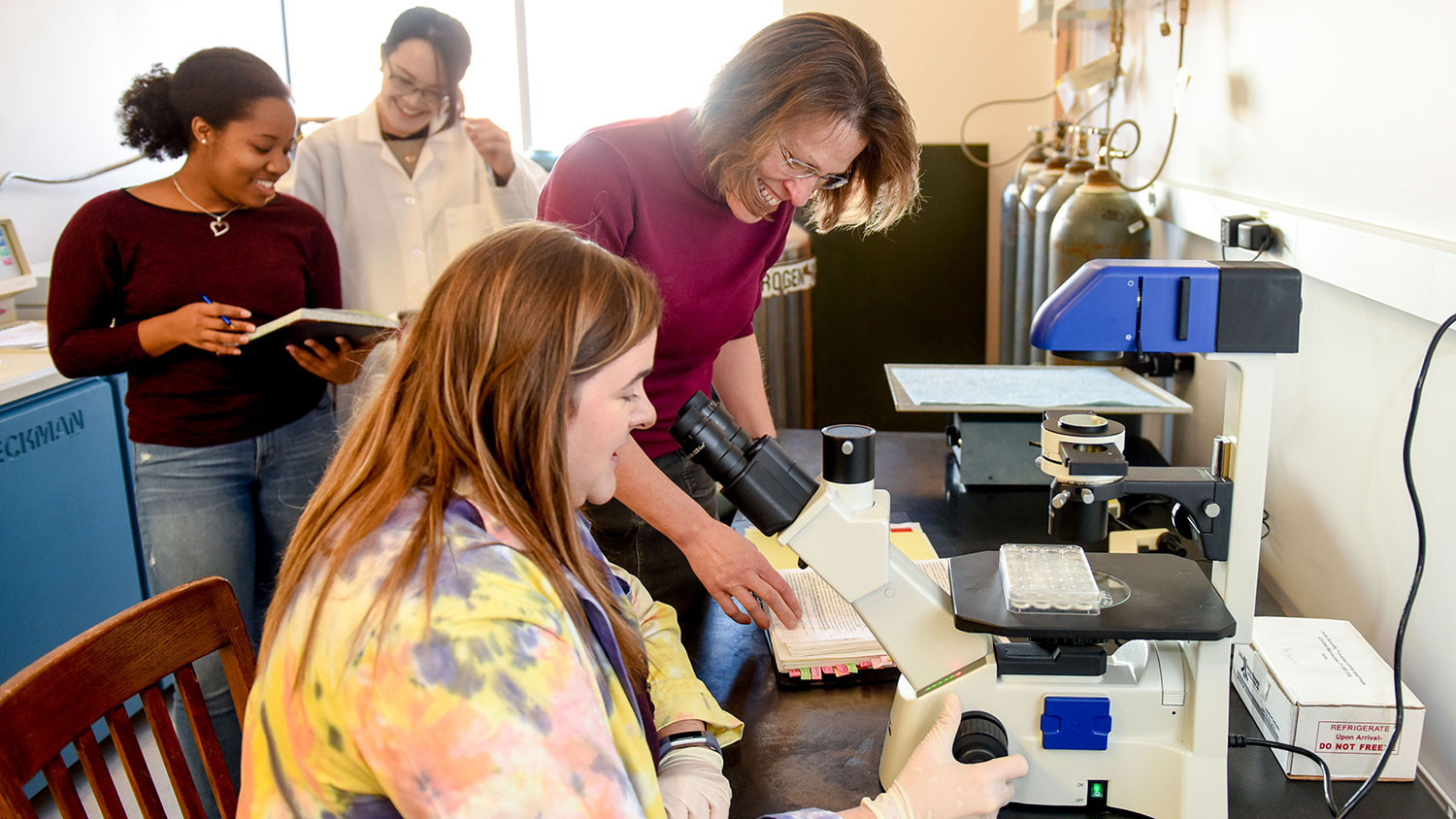 NCState Biochemistry Department Head Melanie Simpson in the lab with students