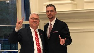 """Chancellor Woodson and Rodolphe Barrangou pose with their """"Wolf hands."""""""