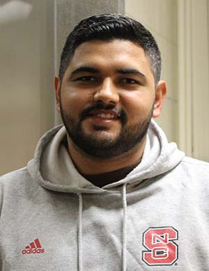 Head shot of Juan Ascencio outside NC State's meat lab