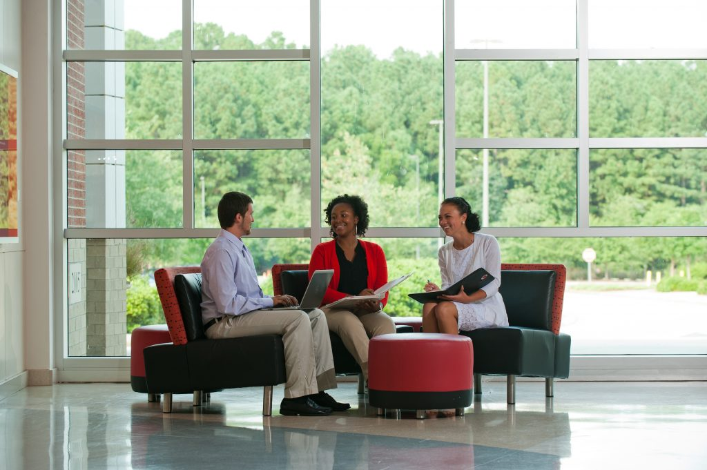 Three students collaborating in meeting area