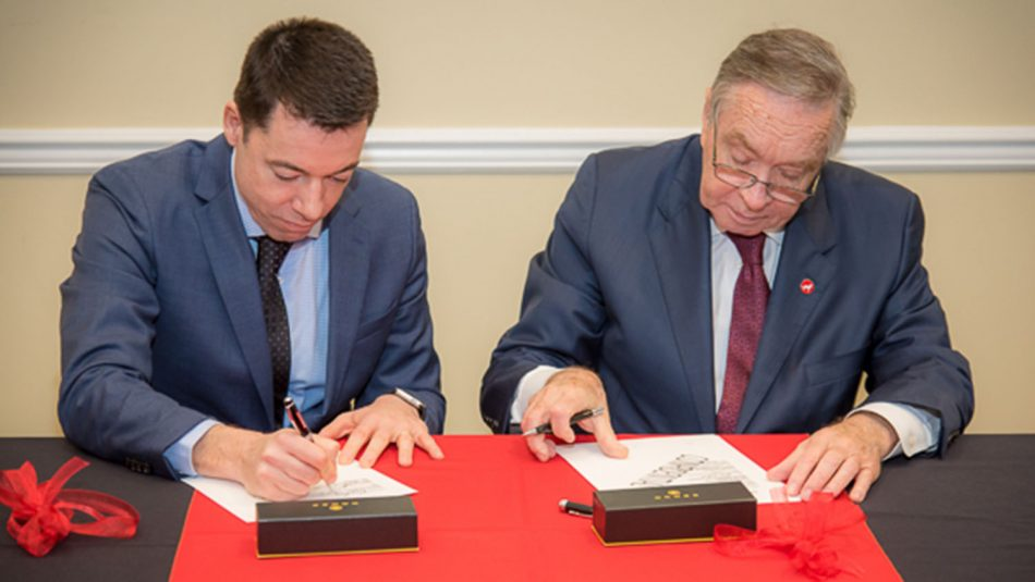 and DSM Nutritional Products'Eduardo Alberto and NCState's Mladen Vouk sign a memorandum of understanding (MOU).