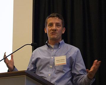Rob Scheller talking at a symposium.
