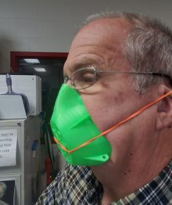A man wearing a 3D printed mask