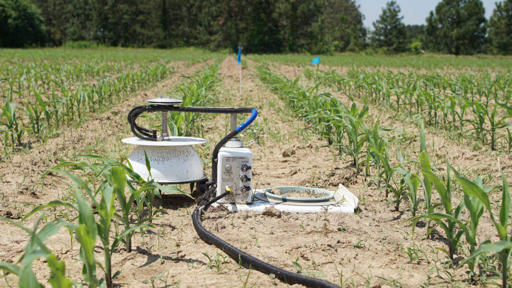 soil emissions device in a corn field